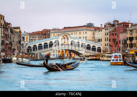 Rialto bridge on the Grand Canal at sunset, Venice, Italy - Stock Image