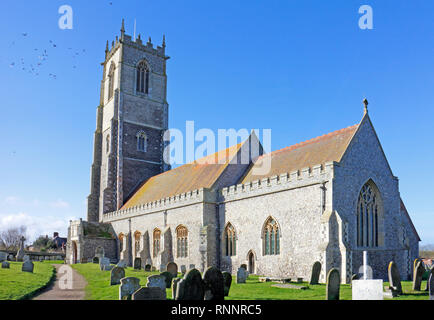 A view of the parish Church of the Holy Trinity and All Saints on the Norfolk coast at Winterton-on-Sea, Norfolk, England, United Kingdom, Europe. - Stock Image