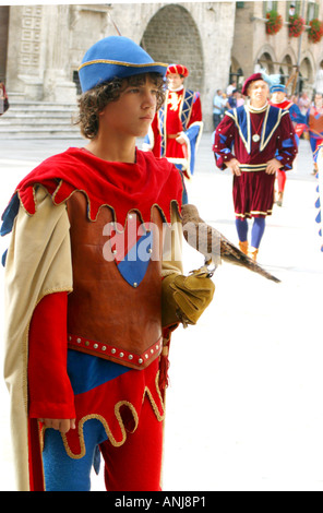 Young costumed 'squire' carries hunting bird in the annual Quintana parade at Ascoli Piceno in Le Marche.the Marches, Italy - Stock Image