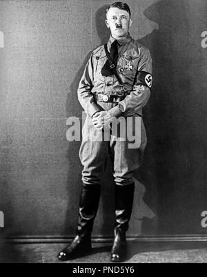 1920s 1930s FULL FIGURE STANDING ADOLF HITLER DER FUHRER WEARING BROWN SHIRT UNIFORM WITH SWASTIKA ARM BAND LOOKING AT CAMERA - q72075 CPC001 HARS PERSONALITY FAMOUS LEADERSHIP MONSTER WORLD WAR II DICTATOR SWASTIKA POLITICS ADOLF DER INFAMOUS MURDERER NAZI FASCIST ADOLF HITLER CONFLICTING DER FUHRER FUHRER GENOCIDE MID-ADULT MID-ADULT MAN MURDER PERSONALITIES SUICIDE BATTLING BLACK AND WHITE CAUCASIAN ETHNICITY FAMOUS PERSON OLD FASHIONED - Stock Image