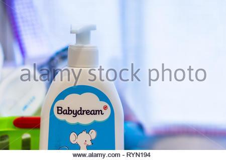 Poznan, Poland - November 18, 2018: Polish Babydream baby bath gel in a plastic bottle in a bathroom by a window. - Stock Image