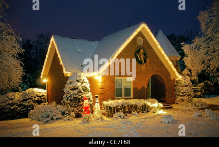 Christmas decorated cottage covered in snow - Stock Image