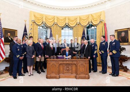U.S. President Donald Trump during the signing ceremony for the Coast Guard Authorization Act in the Oval Office of the White House December 6, 2018 in Washington, DC. - Stock Image