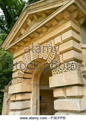 Palladian style temple in ashlar with piers, pediment, rusticated quoins and round roman arch, UK - Stock Image