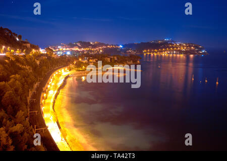 Cap Ferrat peninsula evening view from Villefranche sul Mer, amazing scenery of French riviera, Alpes Maritimes department of France - Stock Image