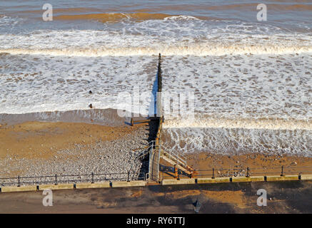 A moderate sea with breakwater on the North Norfolk coast in winter at Cromer, Norfolk, England, United Kingdom, Europe. - Stock Image