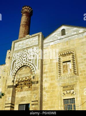 Turkey. Aegean Region. Selçuk. Isa Bey Mosque. Constructed  in 1374-1375. It was built by the architect 'Ali b. Mushaimish Dımısklıoglu, in honor of the Aydinid İsa Bey. View of the facade covered with marble and cut stone. - Stock Image