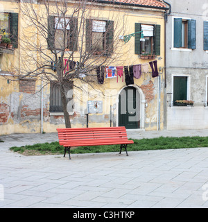 Red bench, Venice, Italy - Stock Image