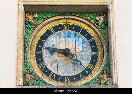 View of the oldest clock in Tallinn sited on the exterior wall of the Church Of The Holy Spirit in the Old Town quarter of the city, Estonia. - Stock Image