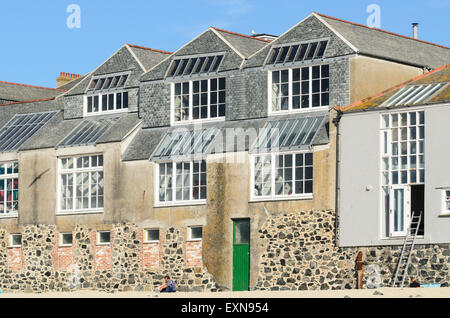 The view of Porthmeor Studios from Porthmeor Beach, St Ives, Cornwall. The studios are converted fisherman's - Stock Image