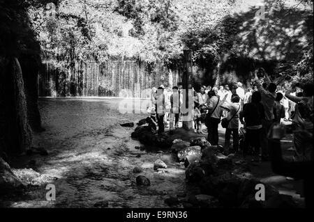 Tourists visiting the Shiraito falls in Karuizawa, Nagano, Japan during the summer, a post displays the name of - Stock Image