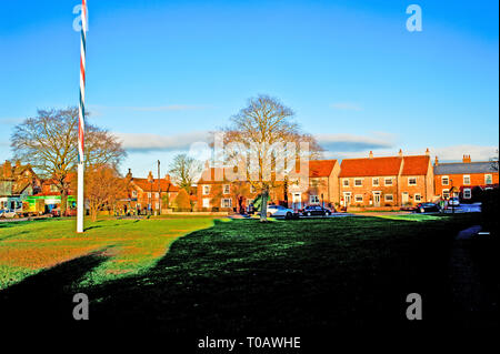 Maypole village green and new build cottages, Upper Poppleton, North Yorkshire, England - Stock Image