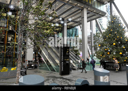 Christmas tree with bauble decorations outside The Leadenhall Building and in the City of London UK  KATHY DEWITT - Stock Image