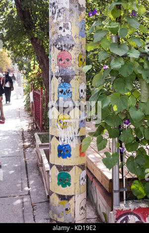 Decorated telephone pole along Baldwin St. in Kensington Market in downtown Toronto, Ontario, Canada - Stock Image