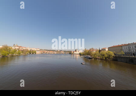 A river between the street in Prague - Stock Image
