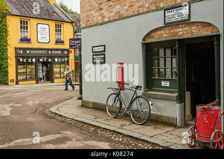 Bicycle leaning against the wall of the post office in the Bunratty Folk Park - Stock Image