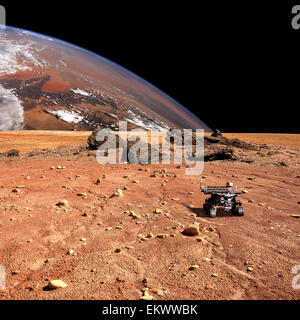 A robotic rover explores a geological feature of a rocky and barren alien world. A large cloud covered planet rises - Stock Image