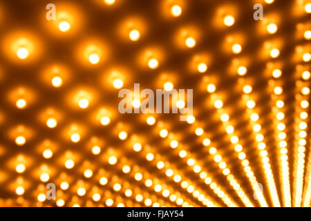 Theater lights defocused out of focus in rows - Stock Image