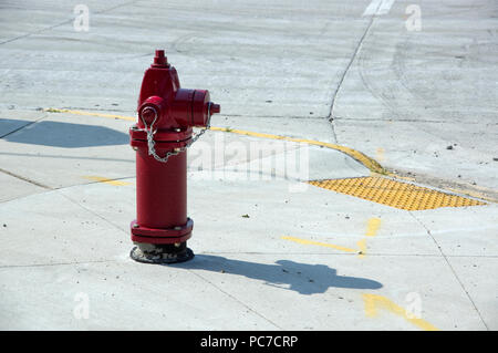 Red fire hydrant at city street corner - Stock Image