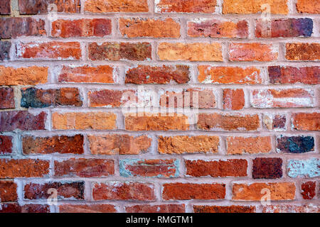 A brick wall built with old bricks - Stock Image