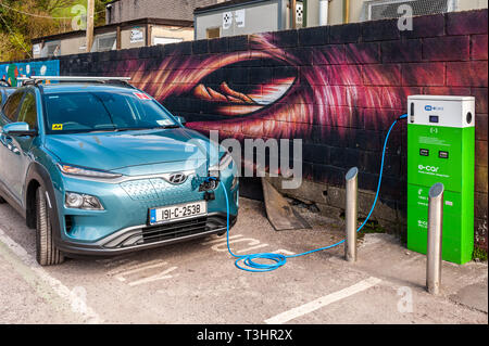 Hyundai electric car being charged at an ESB electric charging point in Bantry, West Cork, Ireland. - Stock Image