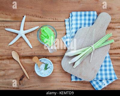Alternative skin care lemongrass scrubs ,Fresh lemongrass and sea salt setup on wooden background. - Stock Image