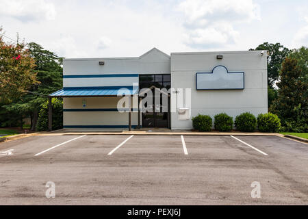 HICKORY, NC, USA-15 AUGUST 18: An empty commercial building along a main street. - Stock Image