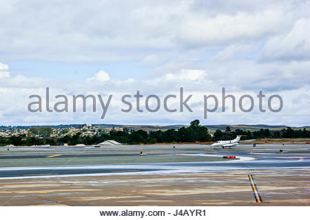 A private jet airplane taxis on the runway of Monterey Regional Airport, Monterey, California, USA. - Stock Image