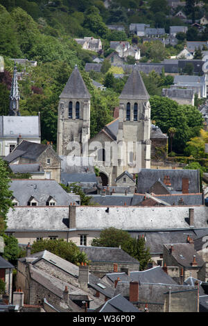 Chinon, France. Picturesque aerial rooftop view of Chinon houses with the former Colligate Church of Saint Mexme (L'ancienne Eglise St Mexme), at Plac - Stock Image