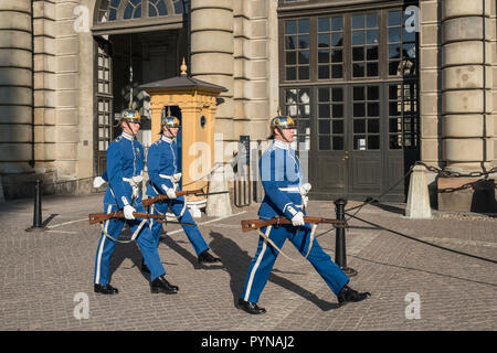 Guards in ceremonial uniform perform changing of the Guard ceremony, Royal Palace, Gamla Stan, Stockholm, Sweden. - Stock Image