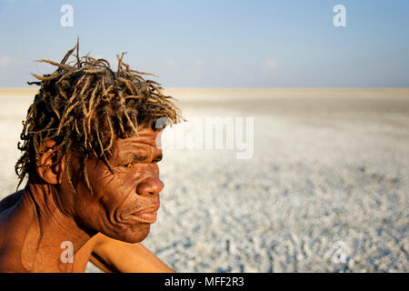 Bushman and vast Makgadikgadi Pan in background. Botswana  Date: 18.12.2008  Ref: ZB538_126466_0024  COMPULSORY CREDIT: NHPA/Photoshot - Stock Image