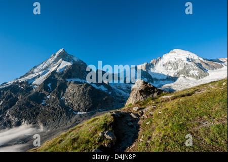 Panorama from Schoebiel SAC mountain hut with matterhorn and dent d'herens mountain peaks, Zermatt, Valais, - Stock Image