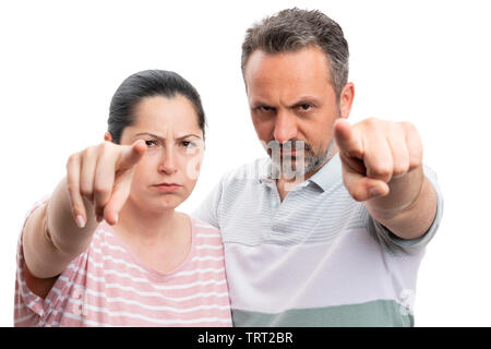 Angry man and woman couple pointing index fingers at camera as looking concept closeup isolated on white background - Stock Image