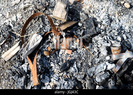 Left over scrap metal and tin after a fire has burnt the metal - Stock Image