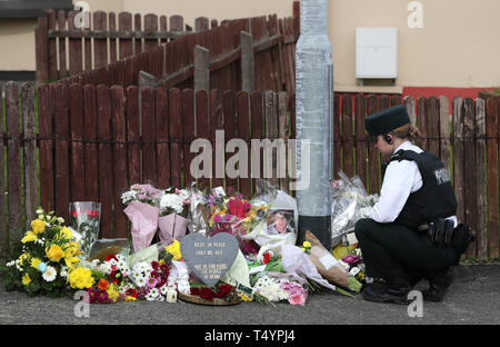 Flowers left at the scene where 29-year-old journalist Lyra McKee was shot last night in Londonderry, Northern Ireland, after guns were fired and petrol bombs were thrown in what police are treating as a 'terrorist incident'. - Stock Image