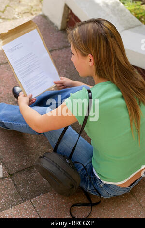 teenage girl reading her exam results - Stock Image