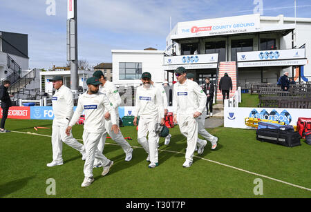 Hove Sussex, UK. 05th Apr, 2019. The Leicestershire players walk out on to the wicket as they take on Sussex in the Specasavers County Championship Division Two match at the 1st Central County Ground in Hove on a sunny but cool first morning of the season Credit: Simon Dack/Alamy Live News - Stock Image