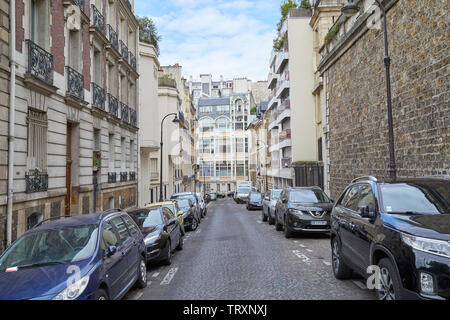PARIS, FRANCE - JULY 23, 2017: Nobody in Paris street, ancient buildings and car parked in a summer day in France - Stock Image