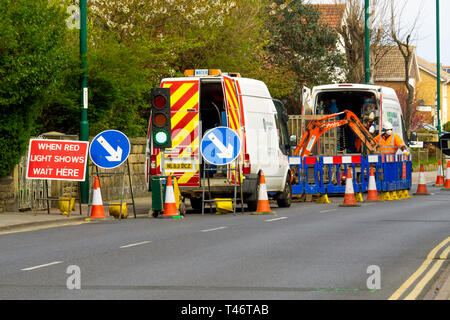 Yorkshire Water contractors connecting a new service in busy road in the Village Centre  Marske by the Sea Cleveland North Yorkshire England UK - Stock Image