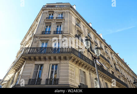 Traditional French house with typical balconies and windows. Paris. - Stock Image