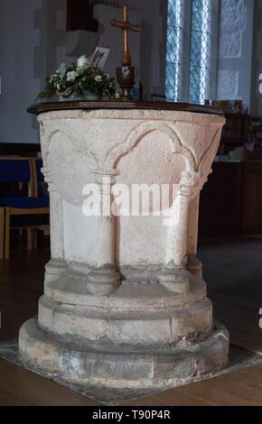 Thirteenth century medieval stone baptism font Church of Saint Margaret, Leiston, Suffolk, England, UK - Stock Image