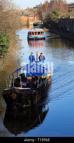 Industry leading the flotilla under Bacon Lane Bridge. 200 years ago on the 22.2.1819 The Sheffield and Tinsley canal opened, with it being celebrated - Stock Image