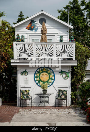 Brightly painted house on Truman Avenue, US highway 1, in Key West Florida - Stock Image