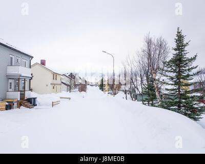 Fridtjof Nansens Gate, a residential street in winter, Kirkenes, Finnmark County, Norway - Stock Image