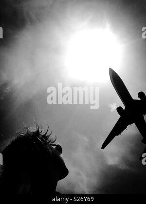Comercial jet airplane landibg in Barcelona airport - Stock Image