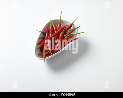 Fresh bowl of red chillies - Stock Image