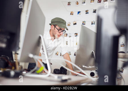 Mid adult man working - Stock Image