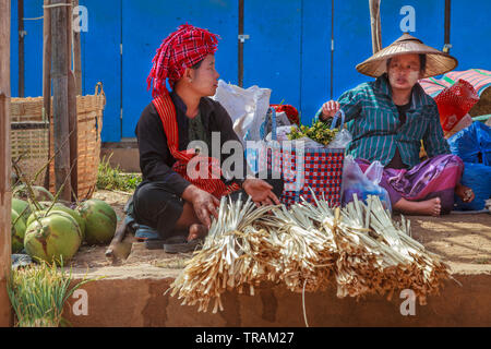 Women selling agriculture products in a village market, Inle Lake, Myanmar - Stock Image