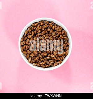 Bowl of Chocolate FLavoured Coco Pops Breakfast Cereals Looking Down With No People - Stock Image