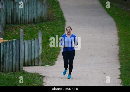 Hastings, East Sussex, UK. 05 Jan, 2019. UK Weather: A chilly start to the morning in Alexandra park in Hastings, East Sussex. A woman enjoys a run around the park. © Paul Lawrenson 2018, Photo Credit: Paul Lawrenson / Alamy Live News - Stock Image